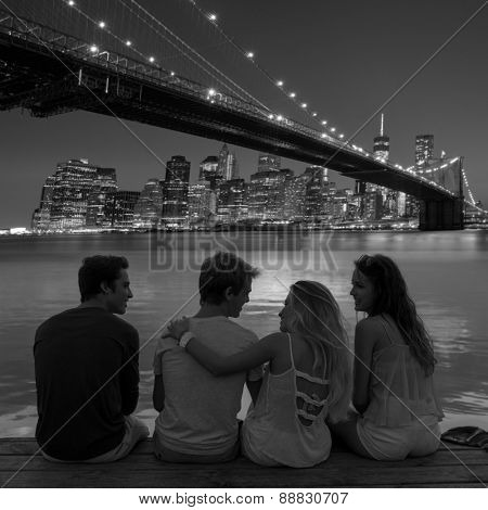 Friends group rear view at sunset happy fun in New York Manhattan photo mount