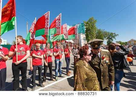 Unidentified Youth From Patriotic Party Brsm Holds Flags On The