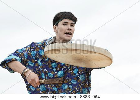 Emotional man dancer dancing with a tambourine. Kamchatka, Russia