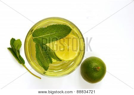 Refreshing Drink of Water Infused With Lime and Mint