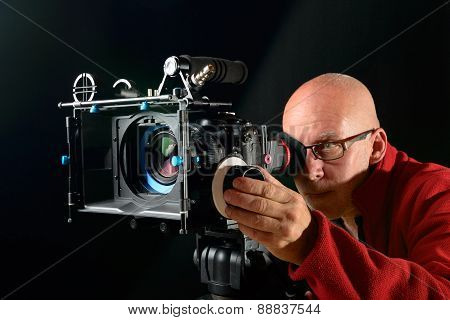 Man With A Professional Movie Camera