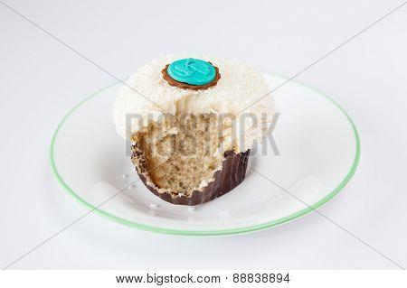Bitten Vanilla Sprinkle Cupcake