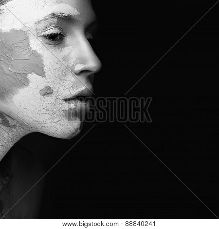 Beautiful girl with mud on his face. Cosmetic mask. Beauty face. Black&white photo