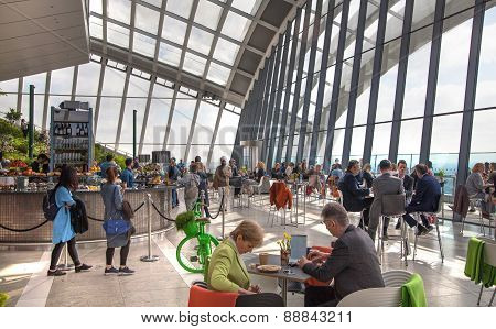 People in the restaurant of the Sky Garden Walkie-Talkie building. View