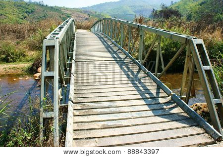 Small Bridge Cross Stream At Vietnamese Countryside, This Bridge Help People Can Go To Field Safety
