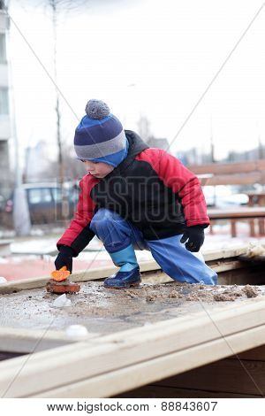 Boy Playing In The Sandbox