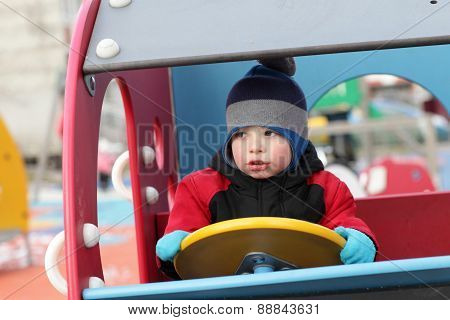 Child Driving Wooden Car