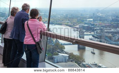 LONDON, UK - APRIL 22, 2015: People looking at the London's skyline. Viewing platform of Walkie-Talk