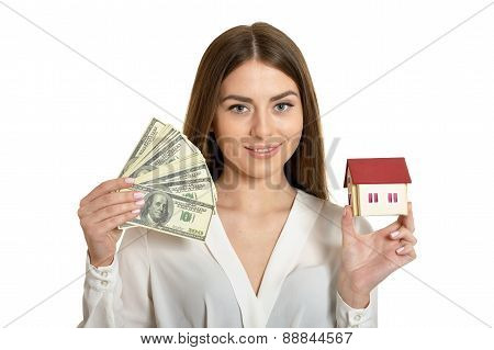 Woman with money and little house