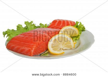 Salted Salmon With Lemon On Salad Leaves