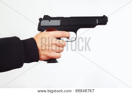 Hand with semi-automatic pistol on white background