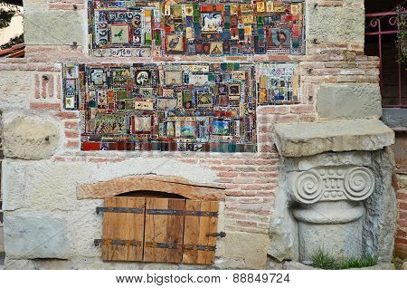 Tbilisi,Georgia-Feb,26 2015:Mosaic fragment of Rezo Gabriadze Falling tower, Marionette Theater