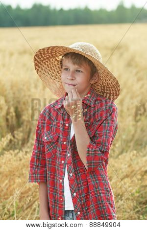 Smiling Teenage Farmer In Wide-brimmed Hat And Oat Cereal Ears Straw