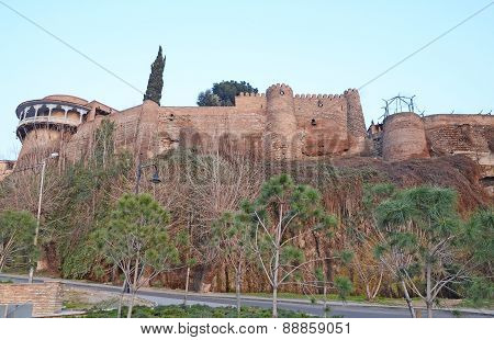 The fortress wall and house on crying rock. Tbilisi
