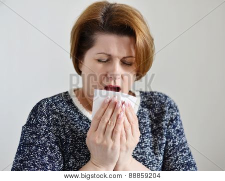 Adult Woman With A Runny Nose