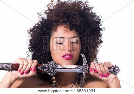 beautiful exotic young tribal woman holding a dagger