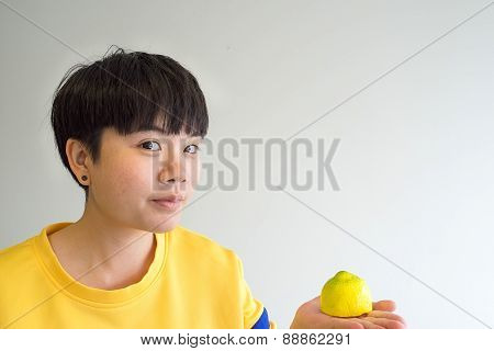 Portrait Of Young Happy Woman With Lemon, Indoors