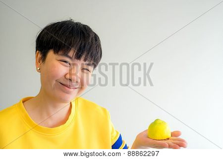 Portrait Of Young Happy Smiling Woman With Lemon, Indoors