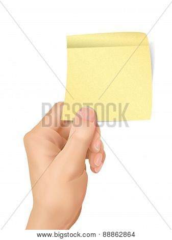 Business Concept: Hand Holding A Sticky Note
