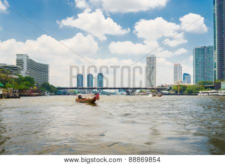 Scenic View Of The Chao Praya River In Bangkok Including Long Tail Boat And River Taxi