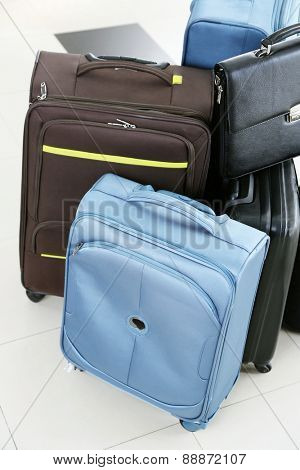 Group of suitcases on floor background