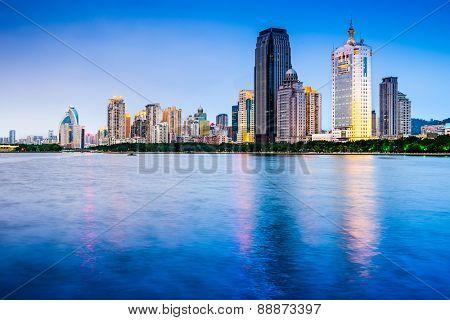 Xiamen, China skyline on Yundang Lake at twilight.
