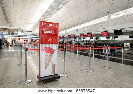 HONG KONG - MARCH 09, 2015: Emirates check-in area in Hong Kong Airport. Emirates is the flag carrier of the United Arab Emirates along with Etihad Airways and is based in Dubai