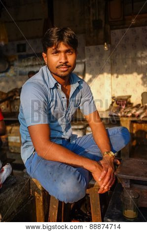 MUMBAI, INDIA - 08 JANUARY 2015: Worker at a fishmarket next to Dhobi ghat posing while waiting for customers.