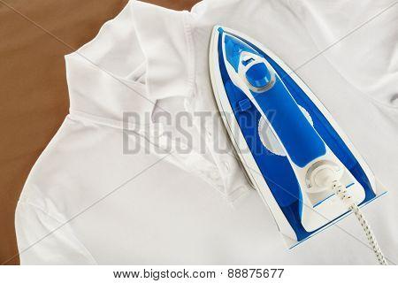 Iron and shirt close up