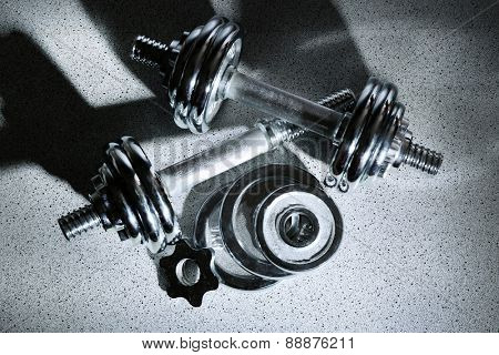 Dumbbells on gray background