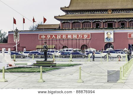 A view on the Forbidden City and the  guards of the flag of China with its from the Tiananmen Square in Beijing, China - April 16, 2015