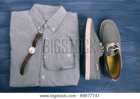 Fashion male clothes and accessories on wooden background
