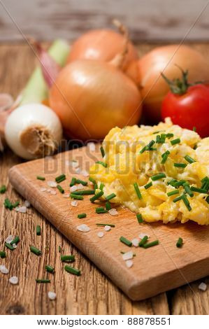 Vertical Photo Of Scrambled Eggs With Chopped Chive