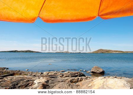 Swedish Coast With Orange Parasol