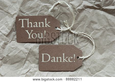 Two Beige Labels Danke Means Thank You Paper Background