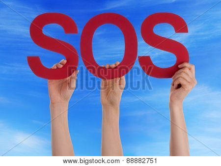 Many People Hands Holding Red Straight Word Sos Blue Sky