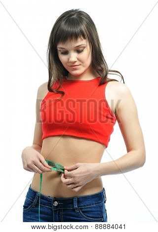 slender young woman measuring her waist