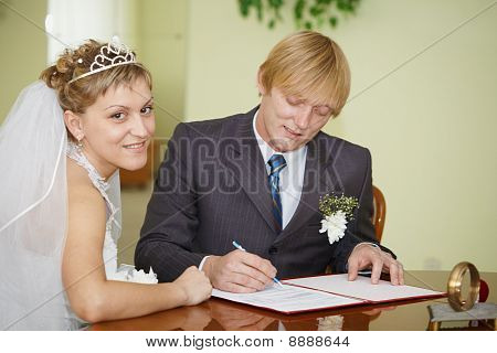 Registration Of Marriage. Happy Newlyweds.