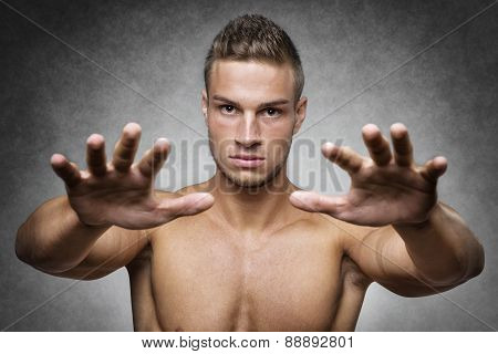 Athlete Holds Up His Hands