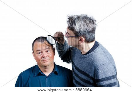 Inspecting His Hairline