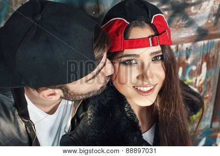Close Up Of Man Kissing His Girlfriend On The Cheek