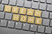 stock photo of dream home  - Golden dream home key on keyboard - JPG