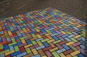 foto of street-art  - Photography of colored pavement, street art in a pedestrian street ** Note: Shallow depth of field - JPG