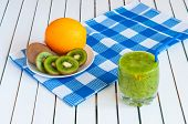 image of light weight  - Healthy homemade kiwi juice in glass and fresh orange - JPG