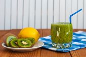stock photo of light weight  - Healthy homemade kiwi juice in glass and fresh lemon - JPG