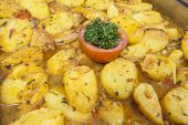 stock photo of buffet  - Closeup detail of moroccan potato dish on display at a hotel restaurant buffet - JPG