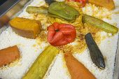 foto of buffet  - Vegetable on a bed of couscous on display at an oriental restaurant buffet - JPG