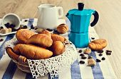 picture of croissant  - Croissants in a wicker basket with lace on the cloth - JPG