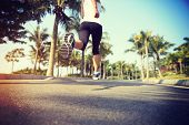 image of jogger  - fitness jogger legs running at tropical park - JPG