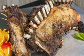 stock photo of lamb chops  - Closeup detail of lamb chops on display at a hotel restaurant carvery - JPG